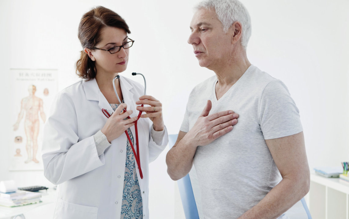 doctor checking the patients heartbeat