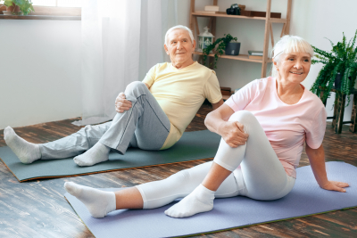 men and woman doing yoga