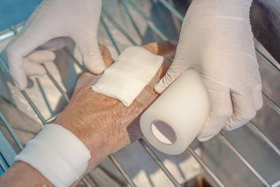 nurse dressing hand wound